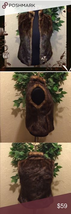 "Express Brown Faux Fur Size XS Express Brown Faux Fur Vest XS~ excellent condition~ dry clean only~ Bust:  31.5"" - 32.5""  Waist: 24"" - 25""    Hips:   35"" - 36"".                                                       Length : 21"" Express Jackets & Coats Vests"