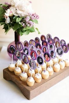If you prefer to use escort cards for guest seating, here is a fun way to do it!  Pictures can be pulled off Facebook and the table names can be put on the opposite side.  A bite-sized cupcake is a perfect way to welcome guests to your reception!      love this idea! guests can walk in, are treated to a sweet treat and can find their table on the other side of their picture!