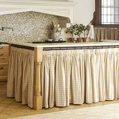I need to make one of these skirts, but I'm not sure how because I can't drill holes for the curtain rods... any helpful hints??