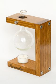 Walter Designer Oil Burner by InscentiveOilBurners  This beautifully handcrafted essential oil burner is made from tasmanian oak and finished with either a clear varnish or cedar stain with varnish. The lab grade boiling flask will ensure many hours of uninterrupted aromas throughout your home. Also includes 5 hour soy tea light candle.