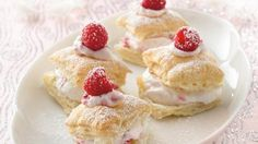 Crisp puff pastry squares are filled with a sweet, cream mixture flavored with fresh raspberries and almond extract or lemon Mini Desserts, Just Desserts, Dessert Recipes, Dessert Ideas, Individual Desserts, Yummy Treats, Sweet Treats, Yummy Snacks, Delicious Food