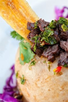 Mofongo and mo'. Fried green plantains are mashed, piled high and topped with meat. Pair this traditional Puerto Rican dish with a classic mojito.