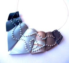 """""""Footprints"""" - polymer clay necklace by Sonya Girodon."""