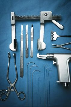 Operating Room: sternal retractor, sternal saw, knives and suture for open heart surgery