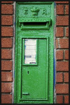 """""""Irish letterbox - But do you notice how the letters ER (Elisabeth Regina) are still on it - eventhough we won our Independence from England in 1921! These postboxes were originally red - we painted them green. You could call it an Irish answer to an Irish problem."""""""