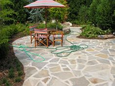 Check out these top patio ideas, patio designs and tricks for making your outdoor ... They pull up to a rustic stone table that echoes the siding's earthen tone.