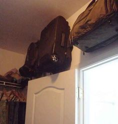 Use the dead space in your closet to hang your suitcases and weekender bags.