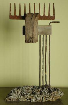 wooden deer with rusty antlers by Oriol Cabrero