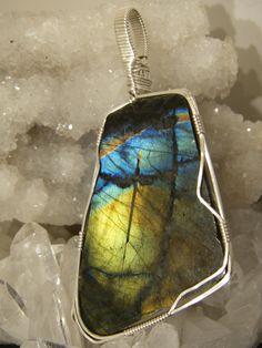 Spectrolite Labrodorite. Stone of spiritual awakening. a flash of light in the darkness