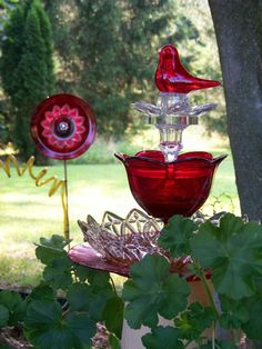 """Glass garden sculpture.  Red and clear glass catches the sun at the end of the day. The glass """"cardinal"""" sparkles in any light."""