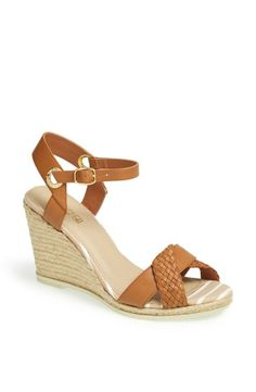 Getting this tan and rope wedge sandals for spring! Love the woven strap detail across the front.