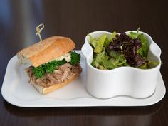 Come into Paramour to try our Chef's Monthly Sandwich for December, as featured in our lunch entrée The Relationship: pulled pork topped with broccoli rabe, sharp provolone and truffle aioli. Pair with soup or salad for just $17