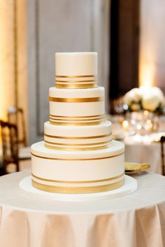 Gold-Striped Ivory Wedding Cake   Olivia Leigh Photography   cake-chicago http://knot.ly/6497BKv6X  