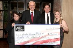 Sanctuary Hotel's owner Hank Freid welcomes the co-founders of Wall Street Rocks to distribute $25,000 in aid to the Wounded Warrior Project. Click to read the full article.