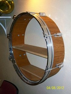 For a music room . My Drum Shelf I Made. i radially cut a Drum, and then took off the god-awful plastic covering, sanded, stained and polished everything. Then a Fit a few shelves and a round Front piece. It works great in our Music Room Music Themed Rooms, Music Furniture, Music Bedroom, Men Bedroom, Drum Room, Drums Art, Music Studio Room, Bedroom Themes, My New Room