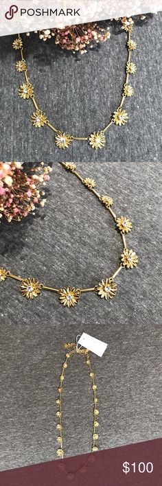 NWT Kate Spade Chain of Daisies Gold Necklace Simple and chic this cute collar necklace has daisies connected by small bar separators to give it form! Each classic gold daisy has a small white crystal center for sparkle and shine! From the front of thenecklace to the backthe daisies gradually get smaller in size for a clean, centered look! Perfect condition, never worn! kate spade Jewelry Necklaces
