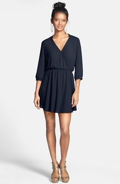 Free shipping and returns on Lush 'Kendal' Surplice Faux Wrap Dress (Juniors) at Nordstrom.com. A banded neck and cuffs add chic sophistication to a faux-wrap dress with a soft, flowy silhouette.