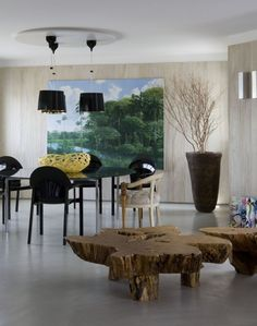 Urban Forest Interior by Fábio Galeazzo. organic wood table combined with traditional hard line. chairs. furniture. dining room