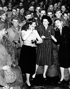 The Andrews Sisters (Patty, Maxine and LaVerne) entertaining the troops during World War II