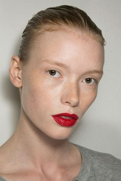 Red lipstick is classic, of course, but never have makeup artists been so united on the shade front as they were this season. The color to know: Snow White apple red—as true as it gets. The finish—satin