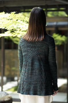 A cardigan knit from back neck toward the bottom in one piece. Two lines of…