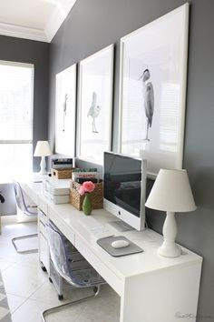 Ikea Micke desk setup in home office for two. It can be for one. I like the pop of white against the grey. Nice idea.