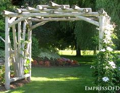 Garden arbor made of rough-hewn logs via EmpressofDirt.net.