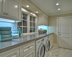 Laundry Room. I love the idea of having  the washer & dryer under a counter with plenty of cabinets.The windows are a must have!!
