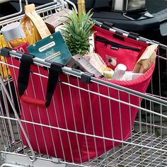Collapsible shopping bags go from the cart to the car~no more plastic bags!