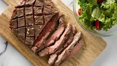 How to cook London Broil. This inexpensive cut of beef with the fancy-sounding name stretches the food dollar and provides a tasty, easy-to-prepare steak dinner. Grilled Fish Recipes, Healthy Grilling Recipes, Meat Recipes, Cooking Recipes, Cooking Tips, Cooking London Broil, London Broil Recipes, Cooking Courses, Dinner Entrees