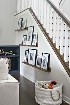 The Pottery Barn look for WAY less The Pottery Barn look for WAY less Pottery Barn picture ledges for a fraction of the price<br> Simple DIY picture frame ledges to fill odd wall space under the stairs. Get the Pottery Barn look for WAY less! Pottery Barn Look, Pottery Barn Inspired, Stair Walls, Staircase Wall Decor, Wall Decor For Stairway, Stair Landing Decor, Stair Decor, Wood Walls, Barn Pictures
