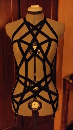 Let loose your inner Dom and Dirty Girl!  Super sexy full body dress is complete with garter clips a gorgeous sassy diamond patterned open design.