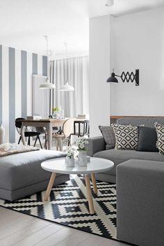 Хотя дизайн этой современной квартиры в Варшаве площадью 80 кв. м и построенна нейтральнойбелой-серой цветовой гамме, интерьер никак нельзя назвать скучным и неинтересным. Квартира оформлена в лучших традициях скандинавского дизайна — строго, минималистичнои с акцентом на стильные детали. Противопоставлениебелого и разных оттенков серого просматриваетсяпрактически во всем: обои в гостиной, текстиль, плитка на кухне и в …