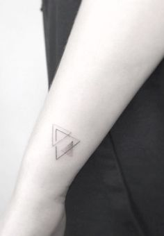Triangles tattoo by Jakub Nowicz