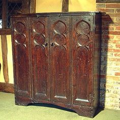 TV cupboard in solid oak, Tudor style. English handmade and based on a 16th century oak hutch. Doors are bi-fold and can either swing back round to the sides on purpose made hand-forged hinges, or slide back inside on special runners. TV can be mounted on a fixed backboard or on a runners with turntable or on an extending arm. #earlyoakreproductions #interior #interiors #tudor #tudors #inspiration #styling #tvcabinet #lifestyle #oakfurniture #madeinengland #handmade #craftsman #traditional #... Tv Cupboard, Tv Stand Cabinet, Medieval Furniture, English House, Tudor Style, Tv Cabinets, Old English, Panel Doors, 16th Century