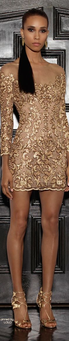 This amazing champagne color is distinctive and intense. The golden embellishments covering the entire dress are dazzling. This long sleeved, just above the knee, is nothing short of perfection. Absolute !!!