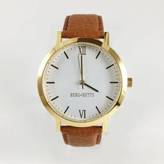 Modern round watch in gold with a camel leather strap. Ethical watches made with scrap leather that would otherwise go to waste. Watch Case, Gold Watch, Camel, Rose Gold, Watches, Band, The Originals, Silver, Leather