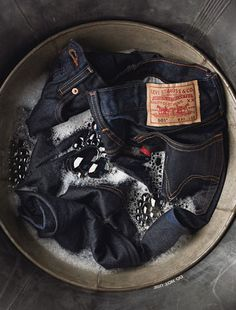 levis  Best method to extending and preserving the color of your jeans is to let them soak in clear vinegar water (2 cups per gallon) and allowing it to soak in overnight. You'll probably want to wash them immediately but let them dry manually first.