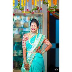 South Indian bride. Diamond Indian bridal jewelry.Temple jewelry. Jhumkis. Turquoise silk kanchipuram sari with contrast blouse.Braid with fresh flowers. Tamil bride. Telugu bride. Kannada bride. Hindu bride. Malayalee bride.Kerala bride.South Indian wedding.