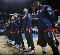 Thunder players stand for the national anthem before an NBA basketball game between the Oklahoma City Thunder and the New York Knicks at Chesapeake Energy Arena in Oklahoma City, Friday, Nov. 20, 2015. Photo by Nate Billings, The Oklahoman
