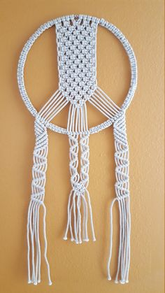 Dreamy handmade macrame wall hanging, made with 3mm macra-made rope, metallic thread and a 12 brass ring. Measures approx. 30 total length. Would make a lovely gift!  SHIPPING Ships in 48 HOURS after your payment and let you know the tracking number. All items will be shipped by Registered mail. You can follow your items on web with tracking number provided.  PAYMENT Accept PAYPAL or Credit card..  Thanks for visiting my shop. Meet the owner of Bizi