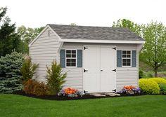 The quaint overhang gives the Quaker shed a charming look. Vinyl Storage Sheds, Vinyl Sheds, Outdoor Storage Sheds, Outdoor Sheds, Shed Storage, Built In Storage, Backyard Studio, Backyard Sheds, Garden Sheds