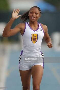 Allyson Felix of L.A. Baptist High takes victory lap after winning 200 meters in national federation record 22.32 seconds in the CIF State track and field championships at Cerritos College.