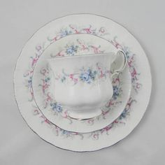 Paragon trio with plate, tea cup and saucer. Pattern is Romance. Silver trimming on cup and saucer and plate edges. All pieces in excellent condition (see photos). For more items in this pattern, please click here to view them: