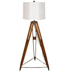A Old Surveyor Tripod Floor Lamp looks great anywhere from your beach house  in the Hamptons to  your mountain retreat in Big Sur.