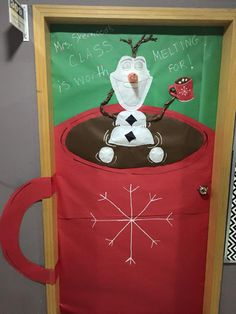 Christmas door decoration for a classroom. Olaf in a mug of hot chocolate. My students came up with this all on their own! Brilliant!