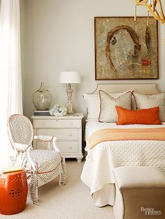 Blue is the longstanding cottage champ, but this master bedroom isn't afraid to deviate. The collected-over-time pieces get a wake-up call thanks to orange accents. Other common denominators weave throughout the room and repeat: The pillow and chair fabrics match, as do the nailhead trim on the headboard and ottomans.