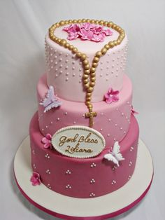 Liliana Communion Cake - I prefer not to repeat cake designs so when I was asked to do a feminine version of my previous baptism cake, I decided to do various shades of pink and purple (Liliana's favourite colours). I think the pearls add a touch of elegance to the cake. I wasn't sure if painting the rosary gold would be overkill but I really like how it looks against the pink. My very first 3 tier cake! Vanilla cake with dulce de leche buttercream (all 3 tiers).