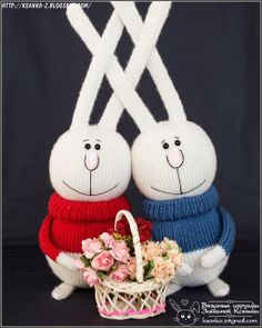 Rabbits knitting from mixed yarn Filler - hollofayber. In the hands, feet, ears - a frame made of wire Eyes - Glass Height 16 cm without ears