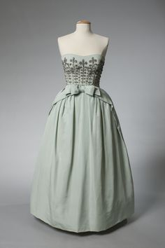 ~Evening Gown, 1959. Bob Bugnand, designed this aquamarine silk faille ball gown for Elizabeth Parke Firestone~